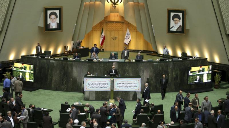 Head of Iran's Atomic Energy Organization Ali Akbar Salehi, center, speaks in an open session of parliament while discussing the bill on Iran's nuclear deal with world powers, in Tehran, Iran, Oct. 11, 2015. Starting Sunday, the approved nuclear deal begi