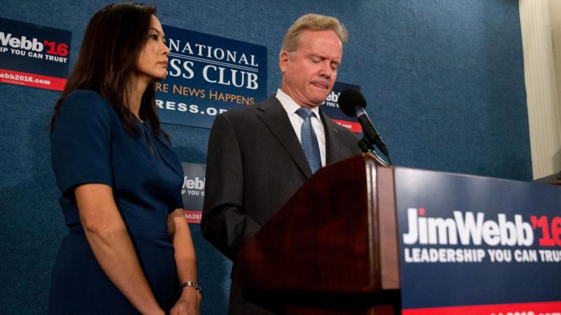 Former Virginia Sen. Jim Webb, accompanied by his wife, Hong Le Webb, announces he will drop out of the Democratic race for president during a news conference at the National Press Club in Washington on Tuesday.