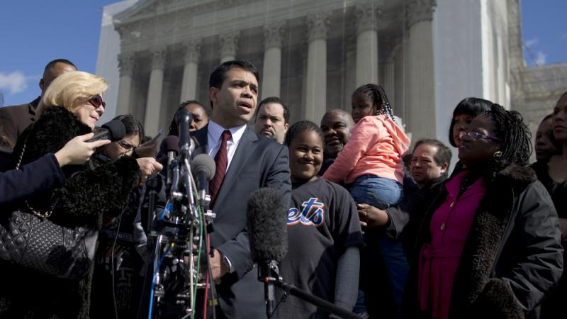 Debo Adegbile, special counsel of the NAACP Legal Defense Fund, speaks with the media outside the Supreme Court in Feb. 2013 after presenting arguments in the Shelby County, Ala., v. Holder voting rights case.