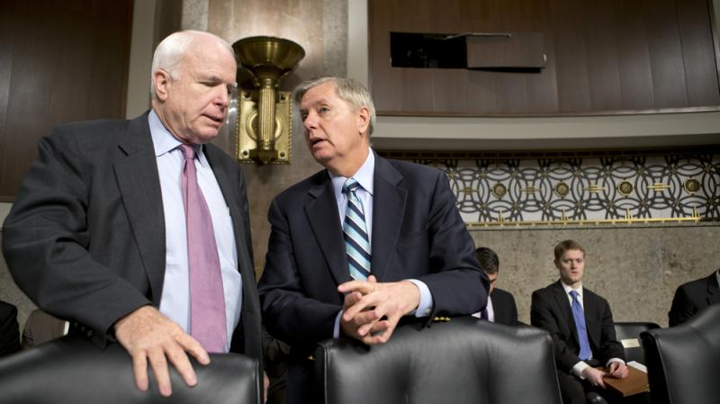 Sens. John McCain, R-Ariz., and Lindsey Graham, R-S.C., confer at the start of a Senate Armed Services Committee hearing last week on the appointments of military leaders. McCain and Graham have been among the Republicans pushing the Obama administration