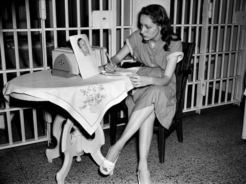 Ruth Ann Steinhagen, then-19, in the Cook County Jail after she shot Philadelphia Phillies first baseman Eddie Waitkus in 1949. On the table: a photo of Waitkus taken in the hospital where he was recovering from his bullet wound. The story of his shooting
