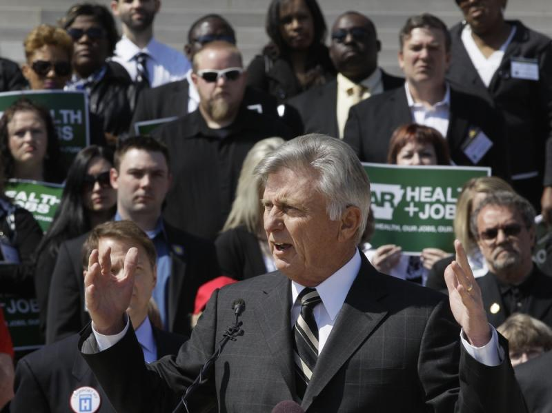 Arkansas Gov. Mike Beebe speaks at a rally promoting the expansion of Medicaid in the state in front of the Capitol in Little Rock on March 7.