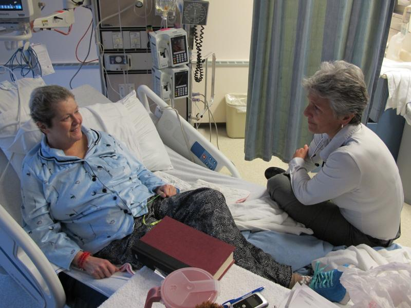 Smith talks with Dawn Dillard, 57, about a medical procedure at Providence Alaska Medical Center in Anchorage. Dillard has uterine cancer.