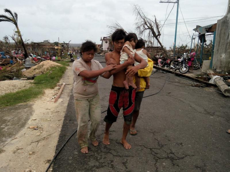 In Guiuan, the Philippines, the typhoon left behind destruction and left people fending for themselves in the first days after.