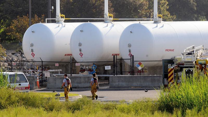Propane cylinders sit on the grounds of Blue Rhino, a propane gas company, in Tavares, Fla. In the Midwest, farmers needed more propane for crops that came in later than normal.