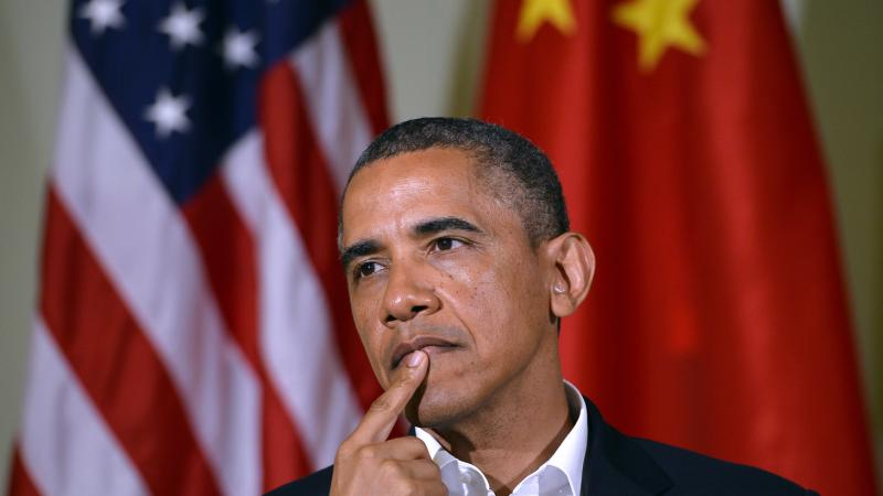 President Obama listens as Chinese President Xi Jinping answers a question after a bilateral meeting in California on June 7.