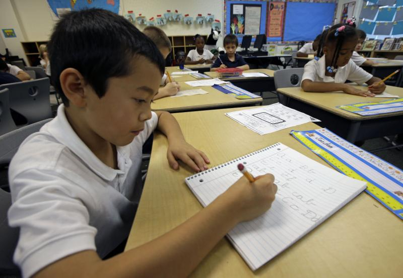 Jaeden Alvarez practices cursive writing at Cleveland K-6 School, Wednesday, Sept. 18, 2013, in Dayton, Ohio. In years gone by, penmanship helped distinguish the literate from the illiterate. But now, in the digital age, people are increasingly communicat