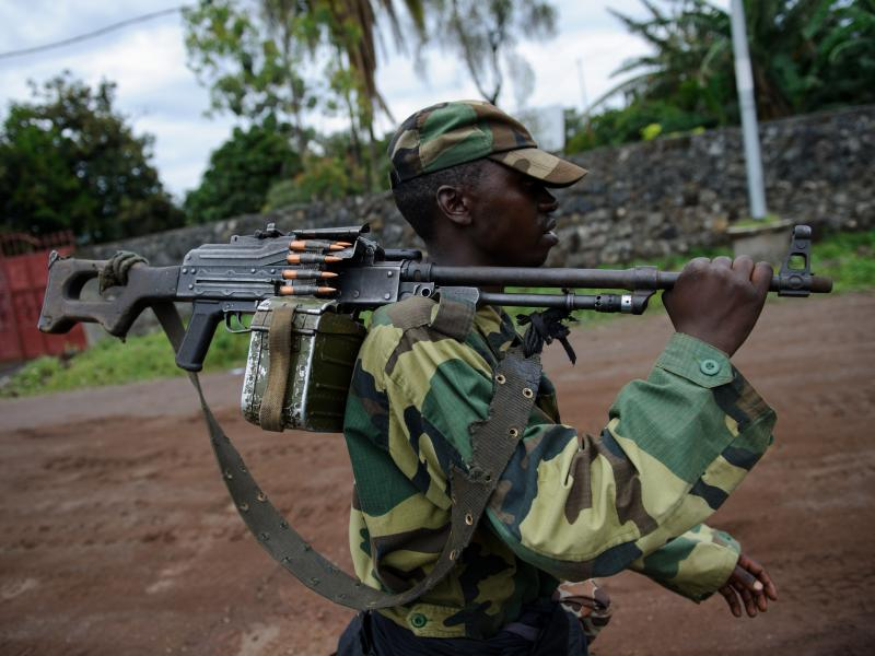 On Nov. 20, an M23 rebel walks on the streets of Goma. The rebels initially claimed control of the town, but retreated 10 days later under international pressure. However, many people think M23 never really left — rather, they just changed into civilian