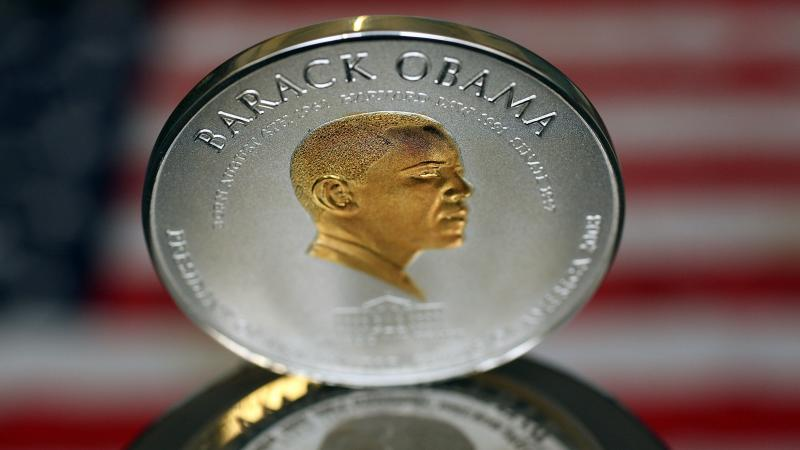 No, this isn't worth $1 trillion. It's a commemorative coin minted in the U.K. in 2008. But some have suggested the president's image should be on it if he orders up a $1 trillion coin.