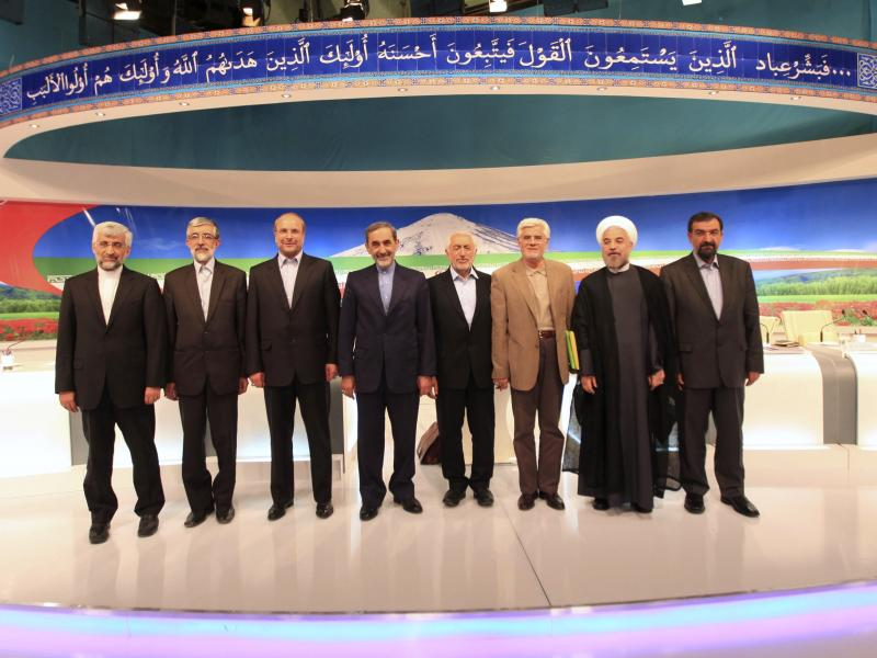 After a TV debate on May 31, presidential candidates at the time appear onstage: Saeed Jalili (from left), Gholam Ali Haddad Adel, Mohammad Bagher Qalibaf, Ali Akbar Velayati, Mohammad Gharazi, Mohammad Reza Aref, Hassan Rowhani, Mohsen Rezaei. Aref dropp