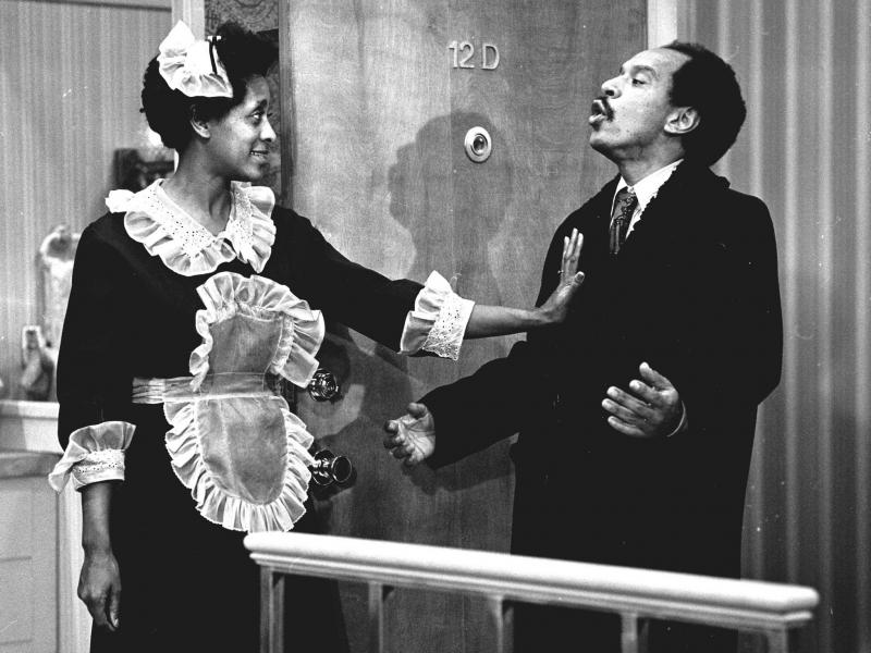 Actress Marla Gibbs (as maid Florence Johnston) and actor Sherman Hemsley (as her boss, George Jefferson), appear in an episode of The Jeffersons.