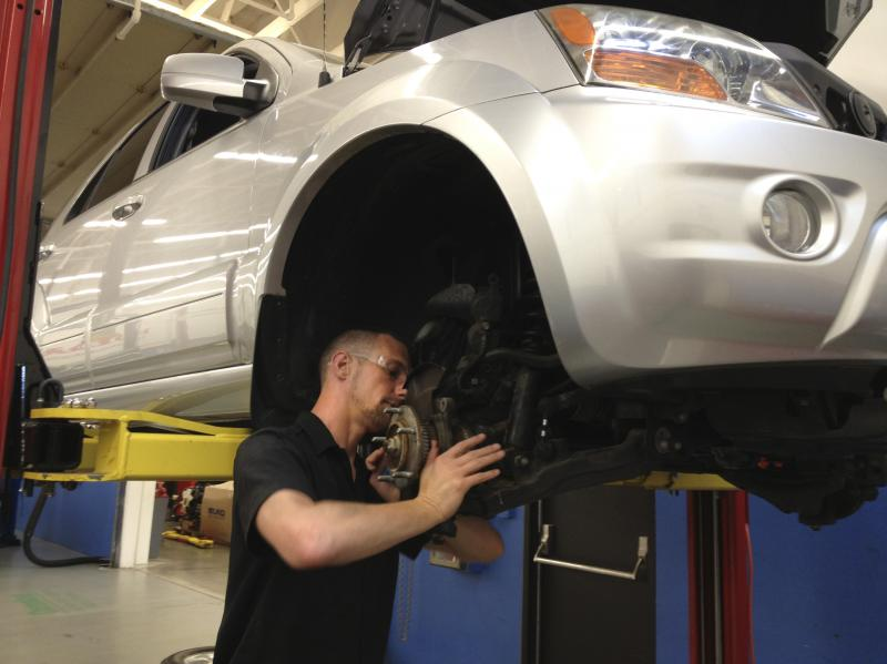 C.J. Forza, a student in the I-BEST program in Washington state, repairs a car for class at Shoreline Community College.
