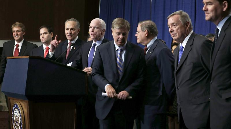 A bill proposed by the Senate's Gang of Eight (from left, Jeff Flake, R-Ariz.; Marco Rubio, R-Fla.; Charles Schumer, D-N.Y.; John McCain, R-Ariz.; Lindsey Graham, R-S.C.; Bob Menendez, D-N.J.; Dick Durbin, D-Ill.; and Michael Bennet, D-Colo.) has passed o