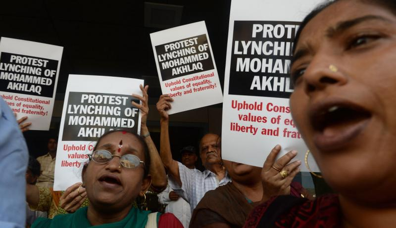 Indian protesters shout slogans during a demonstration to condemn the lynching and murder of an Indian Muslim, in Mumbai on October 6, 2015. Mohammad Akhlaq, 50, was dragged from his house September 29, 2015 on the outskirts of the capital New Delhi and a