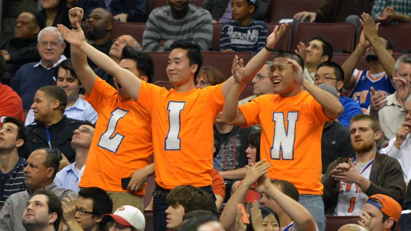 Jeremy Lin fans cheer during a game between the New York Knicks and Philadelphia 76ers in March 2012.
