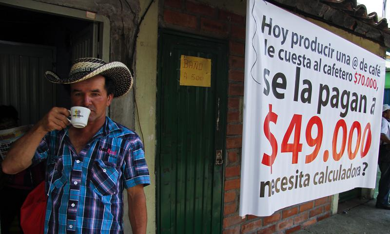 A Colombian farmer sips cofee during a national coffee producers' strike Feb. 25 in Colombia. Thousands of coffee farmers rallied and marched throughout Colombia in protest the economic difficulties of the sector.