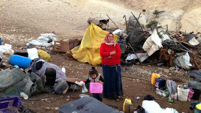 Nehida Bne Menneh stands amid the rubble of her home in a small Palestinian herding camp in the Israeli-occupied West Bank. It was destroyed for being in an area Israel long ago declared a closed military zone.