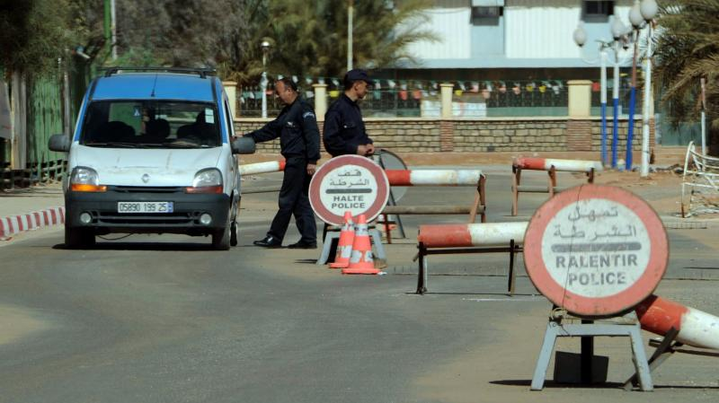 Algerian police stop cars at a checkpoint in In Amenas, deep in the Sahara near the Libyan border, on Jan. 18. Islamists took hostages at a nearby gas field in a major international incident.
