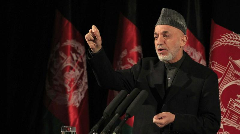 Afghan President Hamid Karzai acknowledged a report this week that the CIA has regularly been sending him money. Afghans seem to have mixed feelings. The president is shown here speaking at an event in Kabul on March 10.