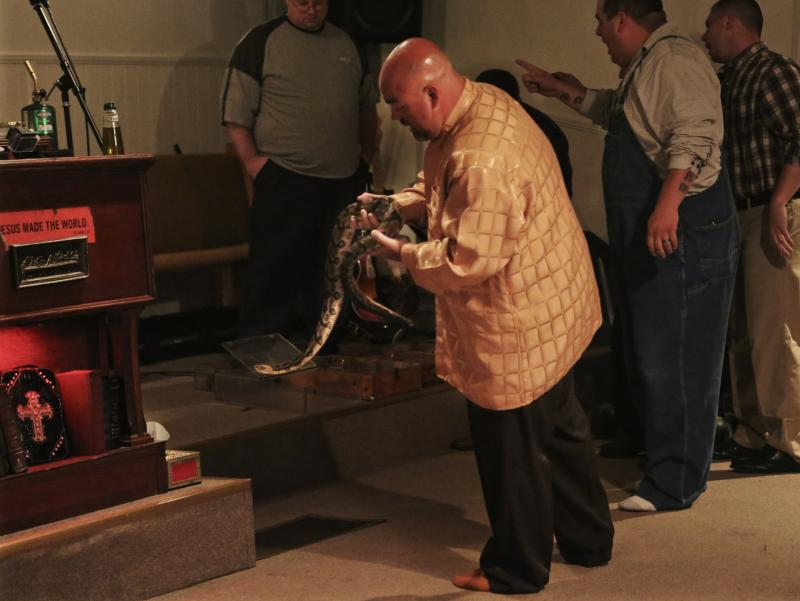 Pastor Jamie Coots holds a snake at Full Gospel Tabernacle in Jesus Name Church of Middlesboro, Ky.