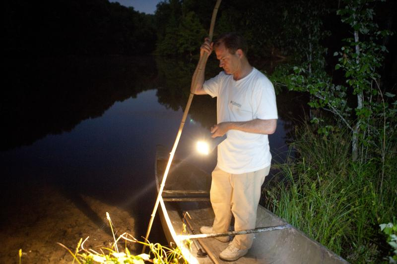 """Tommy Peebles shines a light on the pond. With the help of Bick Boyte, the two Tennesseans catch frogs with homemade """"gigs"""" for a frog leg fry they hold every year."""
