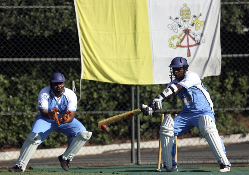 A player from the Vatican's new cricket team of priests and seminarians returns a ball during a training session at the Mater Ecclesiae Catholic college in Rome last month. The Vatican officially declared its intention to defeat the Church of England —