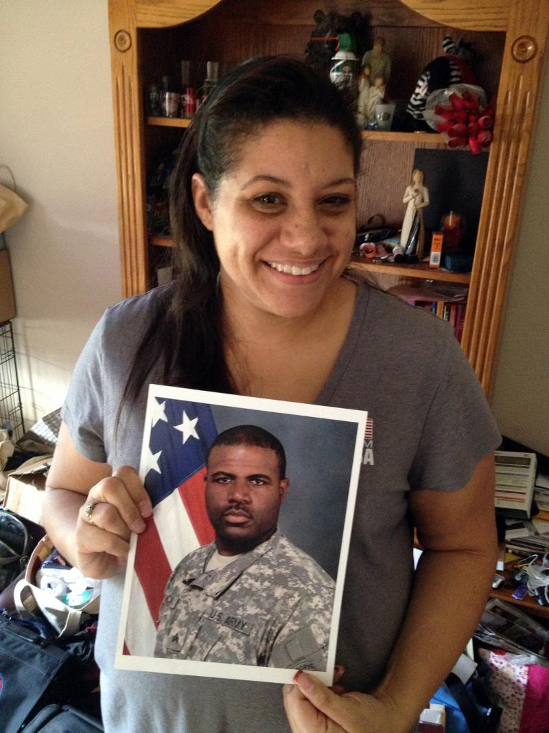 Alicia McCoy holds a photo of her husband, Sgt. Brandon McCoy. Despite taking part in basewide suicide prevention efforts at Fort Campbell in 2009, Sgt. McCoy took his own life in 2012.