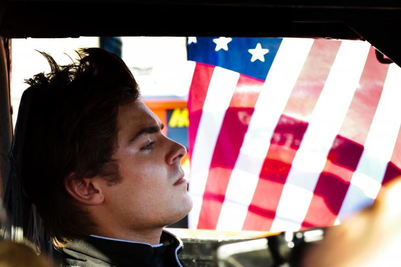 """In Ramin Bahrani's At Any Price, Zac Efron stars as a teen rebelling against his family and dreaming of becoming a professional race car driver. Sound like a generic summer pic? Critic David Edelstein says the film has """"a hell of a sting in its tail."""""""