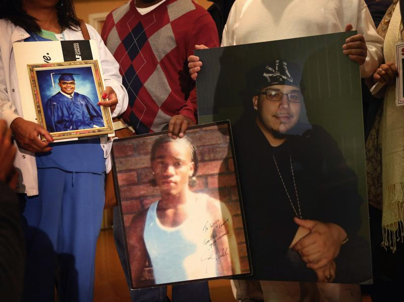 Community leaders and family members of murder victims attend a press conference Jan. 3 at St. Sabina Church in Chicago to make a plea for stronger gun regulations.