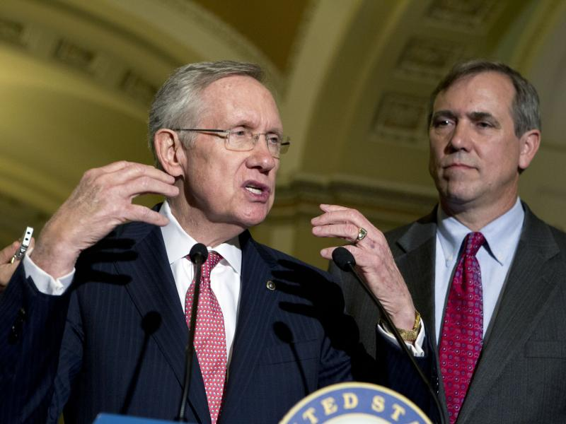 Senate Majority Leader Harry Reid (left) with Democratic Sen. Jeff Merkley on Capitol Hill in July. Both senators favor curtailing the minority's right to filibuster judicial nominees.