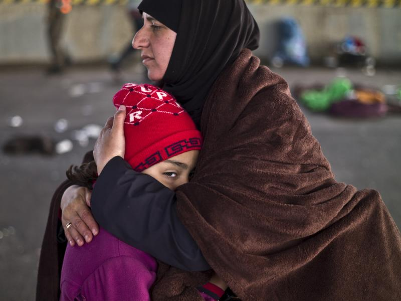 A Syrian refugee mother comforts her daughter after they spent the night in a parking lot on the Austrian side of the Hungarian-Austrian border. More than 4 million Syrians have fled the civil war in their devastated homeland, and such crises can take dec