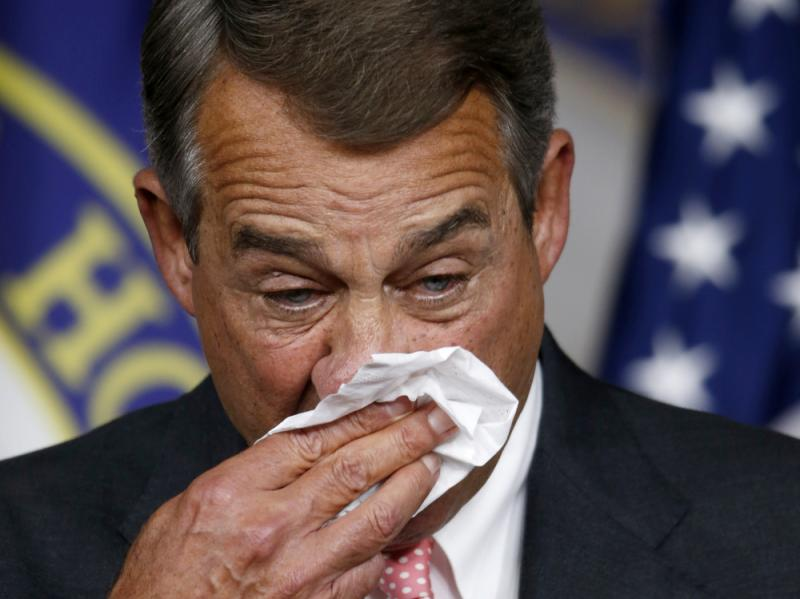 House Speaker John Boehner gets emotional and wipes his face during a news conference on Capitol Hill in which he announced he would be resigning at the end of October.