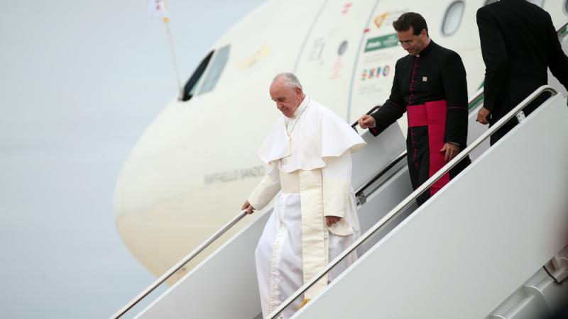 Pope Francis walks down the steps of his plane upon his arrival at Andrews Air Force Base, Md., on Tuesday.