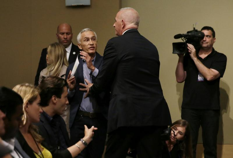 A security guard for Republican presidential candidate Donald Trump removes Univision anchor Jorge Ramos from a news conference on Tuesday in Iowa.