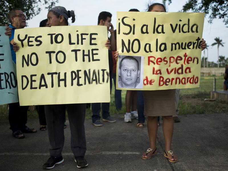 Members of the Nicaraguan Human Rights Center, CENIDH, hold signs against the execution in the U.S. of Nicaraguan Bernardo Aban Tercero in Managua, Nicaragua.