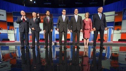 Republican presidential candidates from left, Jim Gilmore, Lindsey Graham, Bobby Jindal, Rick Perry, Rick Santorum, Carly Fiorina, and George Pataki take the stage for a pre-debate forum at the Quicken Loans Arena, Thursday, Aug. 6, 2015, in Cleveland. Se