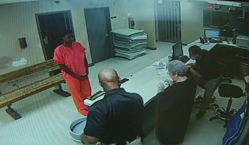In this undated frame from video provided by the Waller County Sheriff's Office, Sandra Bland stands before a desk at Waller County Jail in Hempstead, Texas.