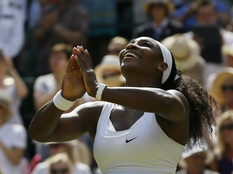 Serena Williams wins the singles match against Garbine Muguruza of Spain after the women's singles final at the All England Lawn Tennis Championships in Wimbledon, London, on Saturday. Williams won 6-4, 6-4.