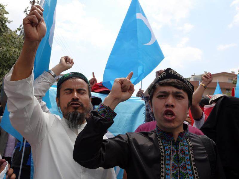 A group of Uighur protesters demonstrate outside the Thai embassy in Ankara, Turkey, on Thursday to protest Thailand's deportation of 100 Uighur refugees back to China.