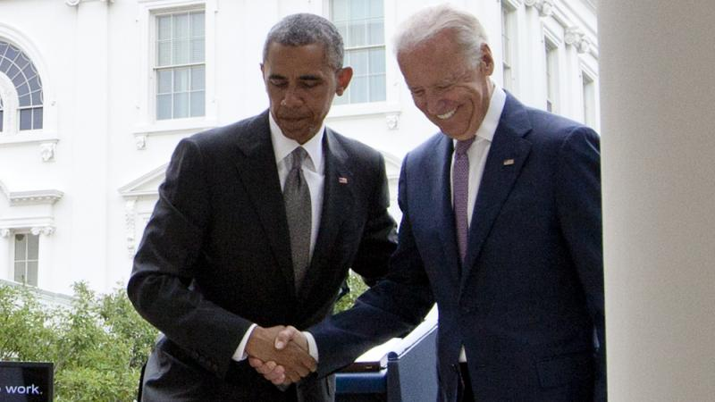 President Obama and Vice President Biden shake hands after the president spoke in the White House's Rose Garden Thursday about the Supreme Court decision in favor of Obamacare.