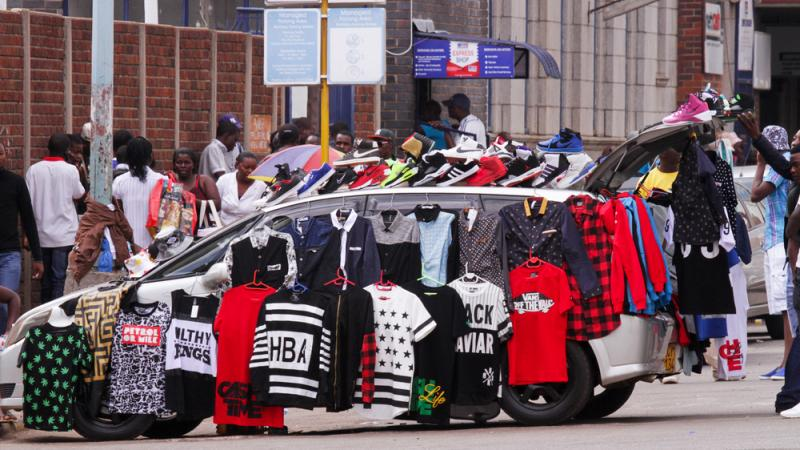 Street hawkers have taken over so many sidewalks in Harare's city center that some vendors are turning their cars into makeshift shops.