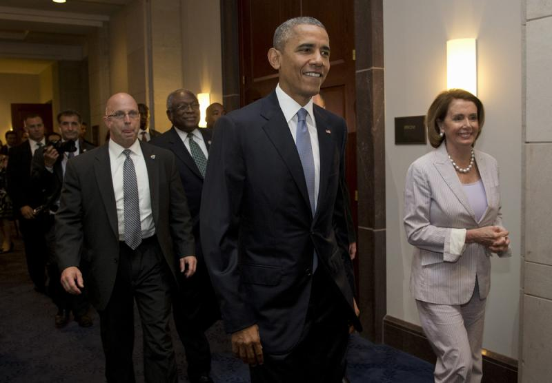 President Obama walks with House Minority Leader Nancy Pelosi as he visits Capitol Hill on Friday.