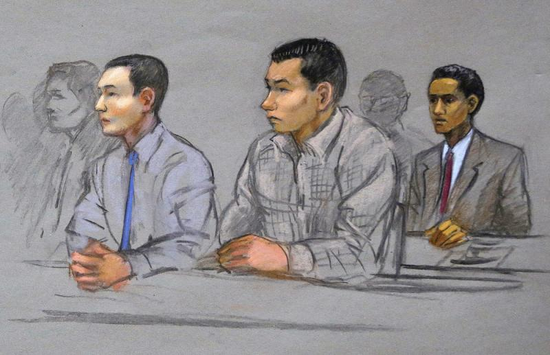 Azamat Tazhayakov, left, Dias Kadyrbayev, center, and Robel Phillipos, right, college friends of convicted Boston Marathon bomber Dzhokhar Tsarnaev, sit during a hearing in federal court in Boston in May 2014.