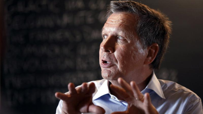 Republican Ohio Gov. John Kasich speaks to a crowd at a restaurant in New Hampshire in May. He's considering a run for president in 2016.