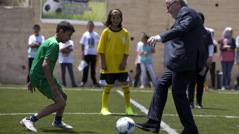 FIFA President Sepp Blatter kicks a ball during the inauguration of a football stadium in the village of Dura al-Qari near the West Bank city of Ramallah on Wednesday. Blatter said he is on a