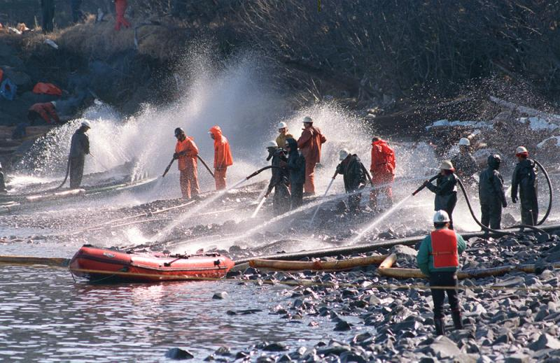 Workers try to remove some of the 11 million gallons of oil spilled by the Exxon Valdez off Alaska in 1989. The ship's third mate may have been up for 18 hours before the accident.