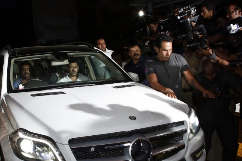 Bollywood actor Salman Khan leaves the Mumbai Sessions Court after the verdict against him on Wednesday. Khan, 49, was sentenced to five years in prison on charges of driving a vehicle over five men sleeping on a sidewalk, killing one of them.