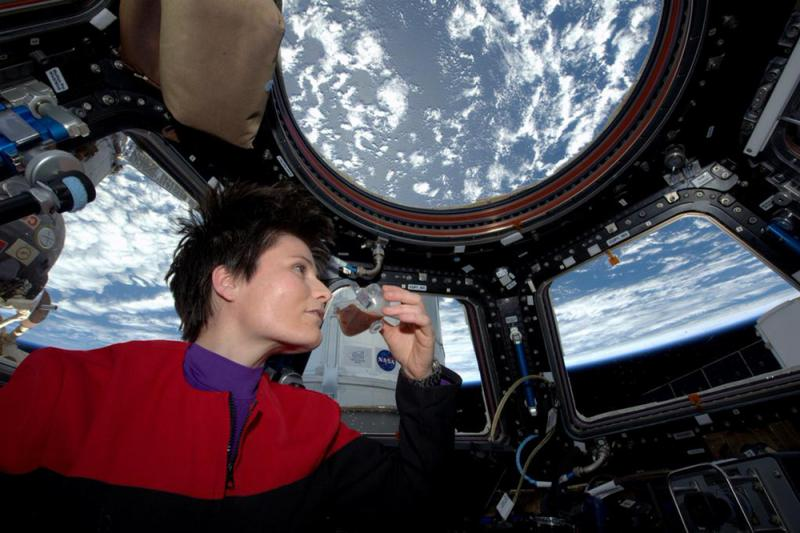In this photo posted on Twitter on Sunday, and provided by NASA, Italian astronaut Samantha Cristoforetti sips espresso from a cup designed for use in zero gravity, on the International Space Station.