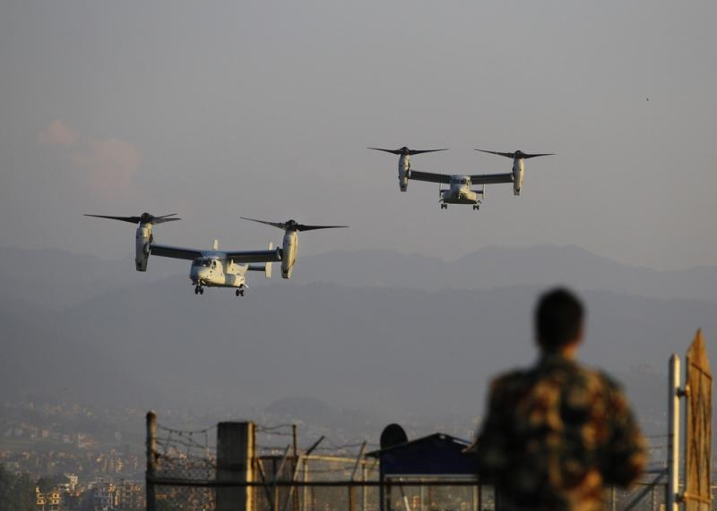 U.S. Osprey tilt-rotor aircraft arrive Sunday at the Tribhuvan International airport in Kathmandu, Nepal. Runway damage had forced Nepali authorities to close the main airport to large aircraft delivering aid to millions of people following the massive ea