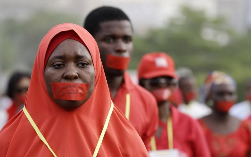 Campaigners marched Monday in Nigeria's capital of Abuja during a silent protest to raise awareness about girls and boys abducted by Boko Haram.
